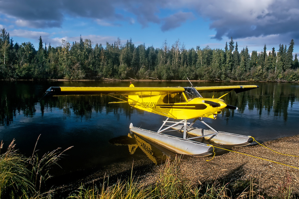 Piper PA18 Super Cub on floats tied up on the edge of Chena River in Fairbanks Alaska