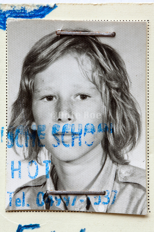 detail of school identity document with photo of a young boy 1970s