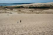 Boy & girl walking in the Nida Dunes, Nida, Lithuania; MRs on file