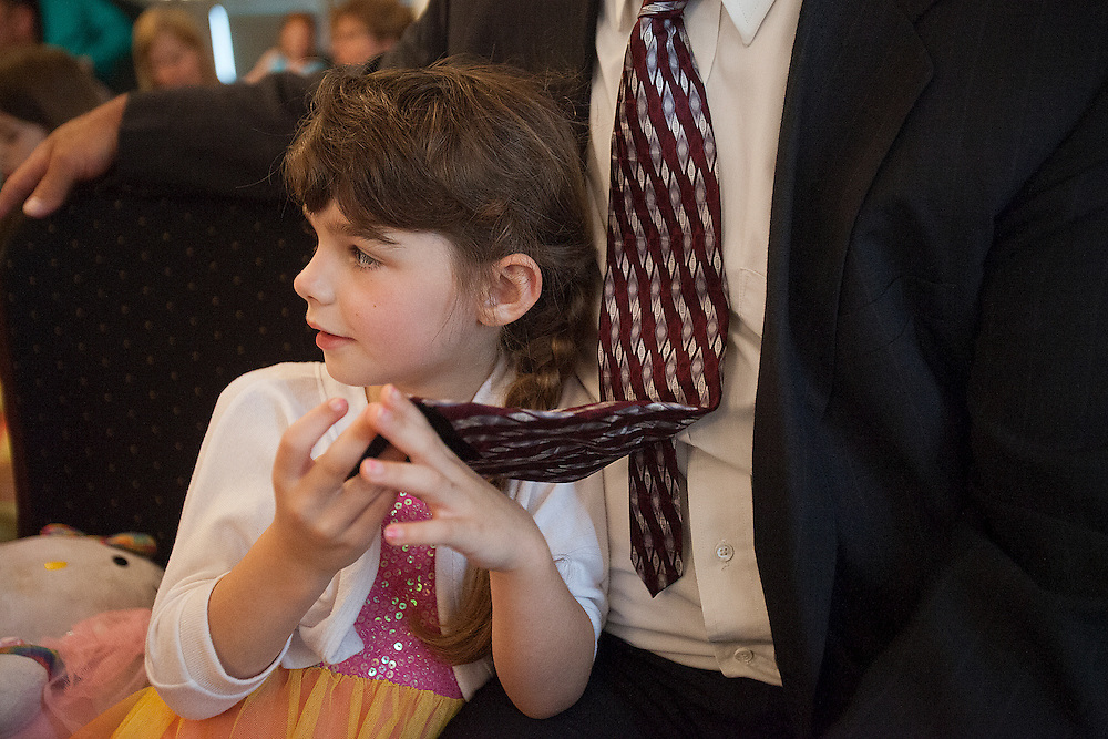 Kiera held onto Dale's tie while attending a family member's wedding in Jasper on May 10. In large crowds Kiera tends to stay close, while Dale encourages her to make friends.