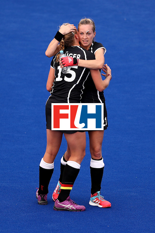 RIO DE JANEIRO, BRAZIL - AUGUST 08:  Hannah Kruger #15 hugs Franzisca Hauke #21 of Germany after defeating New Zealand 2-1 during a Women's Pool A match on Day 3 of the Rio 2016 Olympic Games at the Olympic Hockey Centre on August 8, 2016 in Rio de Janeiro, Brazil.  (Photo by Sean M. Haffey/Getty Images)