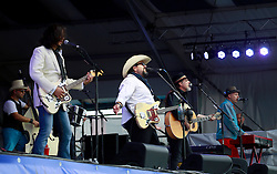 03 May 2013. New Orleans, Louisiana,  USA. .New Orleans Jazz and Heritage Festival. .L/R front. Eddie Perez, Raul Malo and Robert Reynolds of the Mavericks playing the Gentilly stage..Photo; Charlie Varley.