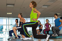 People Exercising in Step Aerobics Class