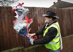 © Licensed to London News Pictures. 11/04/2018. London, UK. A man who gave his name as Iain Gordon removes all the floral tributes from near the house of Richard Osborn-Brooks. Henry Vincent was killed as he burgled the home of 78 year old Richard Osborn-Brooks. Mr Osborn-Brooks was arrested for murder but later released without charge. Friends and family of Henry Vincent have had floral tributes they placed near the scene repeatedly torn down by locals. Photo credit: Peter Macdiarmid/LNP