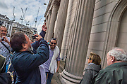 Passing the Bank of England Ai Weiwei give bankers the 'finger' - Anish Kapoor and Ai Weiwei go for a walk in London - The two artists have joined hands to walk out of London on Thursday. Each will carry a single blanket as a symbol of the need that faces 60 million refugees in the world today. The Artists have said that they welcome Londoners to join them along their route and ask that Londoners too bring a blanket in gesture of support. The artists will repeat this action in cities across the world over the next few months. The walk started at 10am on Thursday 17th September, at the Royal Academy of Arts passed: Piccadilly Circus; Trafalgar Square; Whitehall;  St Paul's Cathedral; Bank and ended up at Stratford.