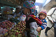 Sapa Market. Black Hmong hilltribe woman with baby child.
