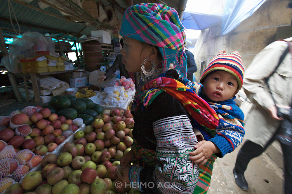 Sapa Market. Black Hmong hilltribe woman with baby child.