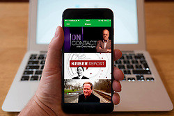 Using iPhone smartphone to display  website of RT, Russia Today, the Russian, English language. news service