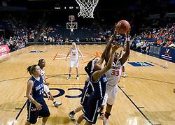 Virginia center Aisha Mohammed (33) shoots against Rhode Island.  The Virginia Cavaliers women's basketball team defeated the Rhode Island Rams 89-53 at the John Paul Jones Arena in Charlottesville, VA on January 9, 2008.