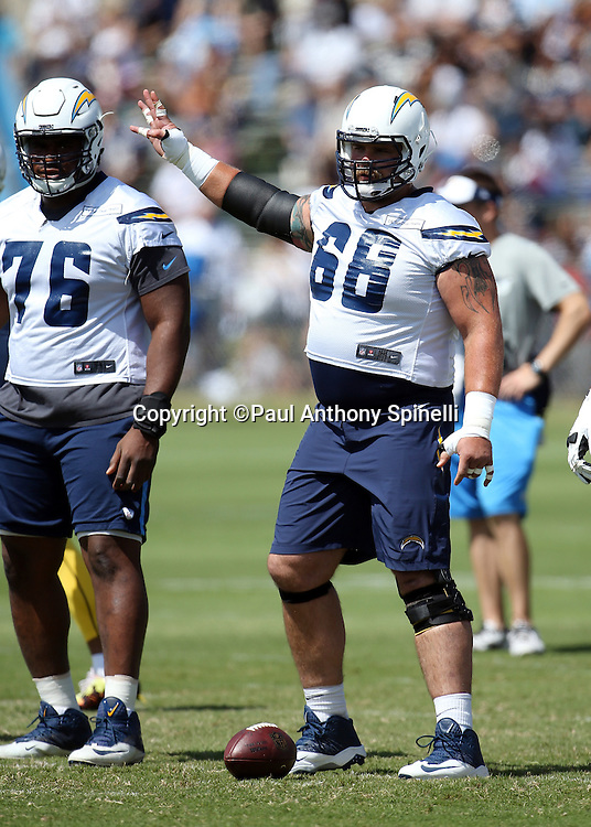 San Diego Chargers center Matt Slauson (68) waves his arm and hand as he gets set to snap the ball at the line of scrimmage during the Chargers 2016 NFL minicamp football practice held on Tuesday, June 15, 2016 in San Diego. (©Paul Anthony Spinelli)