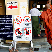 Myanmar (Burma). Yangon. Shwedagon pagoda. Sign saying shoes, socks, short trousers, spagetti straps are forbidden.