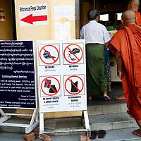 Myanmar (Burma). Yangon. Shwedagon pagoda. Sign saying shoes, socks, short trousers, spagetti straps are forbidden.