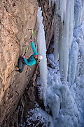 "Champion Mixed climber and mountain guide Dawn Glanc climbing ""Flying Circus"" M8+ in the Ouray Ice Park, Ouray Colorado"