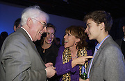 Seamus Heaney, Kathy Lette with her son Julius. The Almeida Theatre Charity Christmas Gala, to raise funds for the theatre, at the Victoria Miro Gallery, London.  1 December  2005. ONE TIME USE ONLY - DO NOT ARCHIVE  © Copyright Photograph by Dafydd Jones 66 Stockwell Park Rd. London SW9 0DA Tel 020 7733 0108 www.dafjones.com