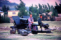ON THE ROAD, 28 July 2005..Children play with an piece of artillery formally used during warfare..