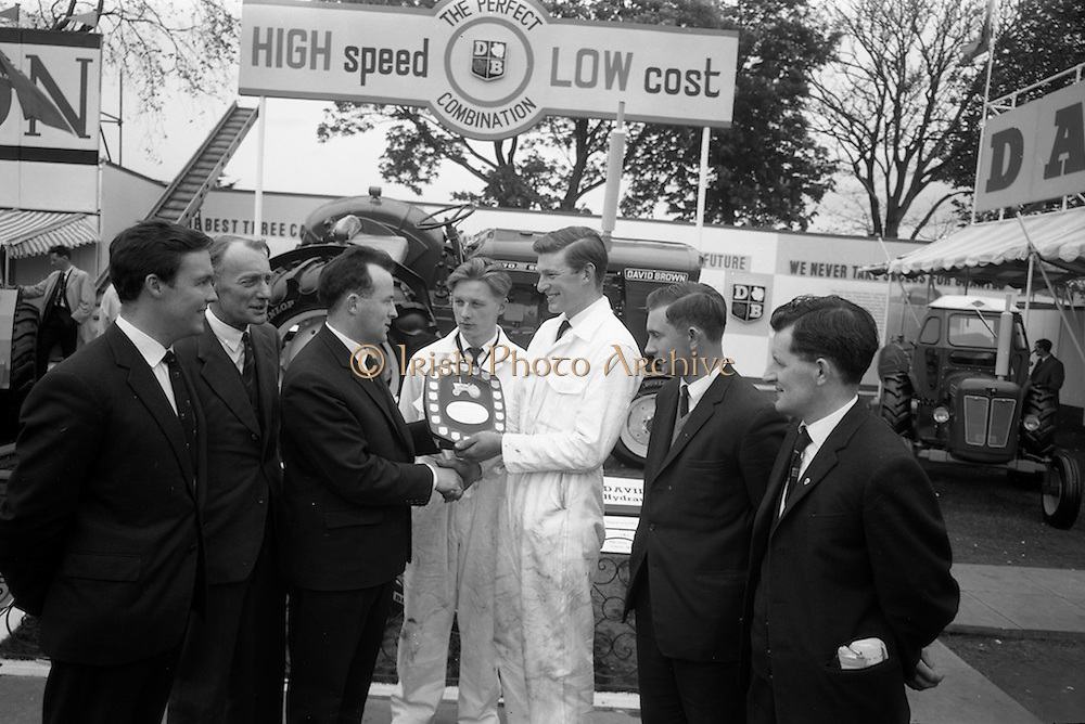06/05/1965<br /> 05/06/1965<br /> 06 May 1965<br /> Final of the 4th Annual David Brown Tractor and Implement Maintenance Competition held at the RDS Spring Show, Ballsbridge, Dublin.  Mr. V.K. Bell, General Manager, David Brown (Ireland) Ltd. presenting the trophy to winner John Kehoe of Tincurry, Ferns, Co. Wexford and his helper, John Denby (centre) of Castlelands. Others in the image are (l-r) Charlie Clayton, Judge, David Brown, Meltham; H.V. Valentine, Competition Manager, Services Manager, David Brown, Meltham; Mr. Patrick Comerford, Judge, Agricultural Institute, Oak Park, Carlow and Mr. Liam Lee, Judge, Department of Education. The winner and his helper would receive special educational scholarships to the David Brown Farm Machinery Service School in  Meltham, Yorkshire, England.