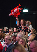 © Licensed to London News Pictures. 23/09/2014. Manchester, UK. A delegate tries to get the attention of the chair. Labour Party Conference 2014 at the Manchester Convention Centre today 23 September 2014. Photo credit : Stephen Simpson/LNP