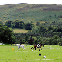 Blair Castle Horse Trials 2012 Photo Essay at Blair Castle, Blair Atholl, Perthshire. Two riders practises their dressage tests in the stunning setting of Blair Castle grounds before entering the main arena.  Picture Christian Cooksey.