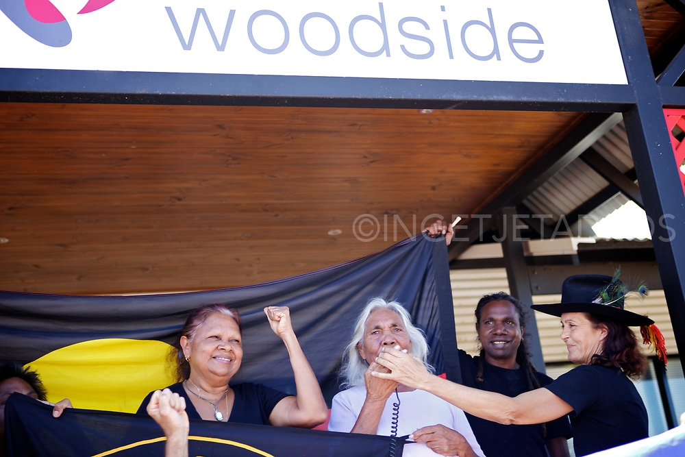 Protesters celebrating in front of Woodside's office in Broome. Woodside's proposal to build a 45 billion dollar gas Hub at James Price Point in Western Australia has been dumped, after its initial plan was judged to be uneconomic. Broome, WA