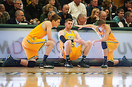 Catamounts forward Zach McRoberts (1), Catamounts forward Brendan Kilpatrick (15) and Catamounts guard Cam Ward (14) wait to get into the game during the men's basketball game between the Binghamton Bearcats and the Vermont Catamounts at Patrick Gym on Monday night January 19, 2015 in Burlington, Vermont. (BRIAN JENKINS, for the Free Press)