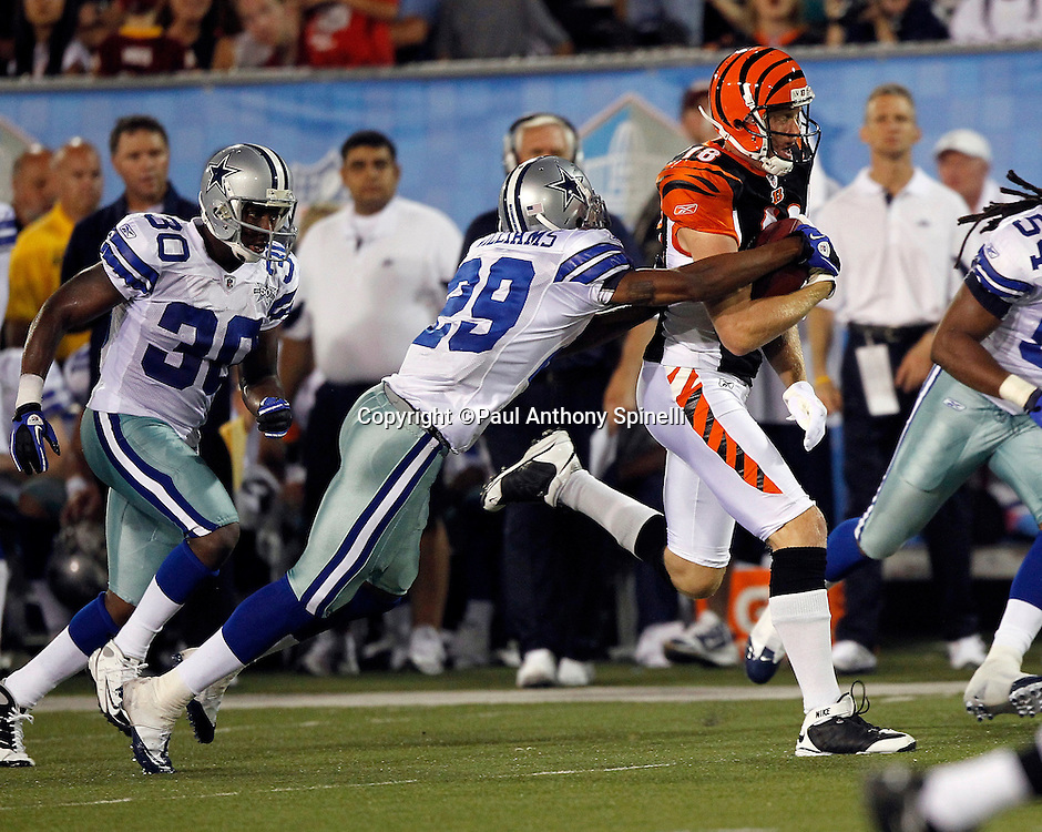 Cincinnati Bengals wide receiver Matt Jones (18) catches a pass good for yardage after the catch while covered by Dallas Cowboys rookie cornerback Teddy Williams (29) during the NFL Pro Football Hall of Fame preseason football game between the Dallas Cowboys and the Cincinnati Bengals on Sunday, August 8, 2010 in Canton, Ohio. The Cowboys won the game 16-7. (©Paul Anthony Spinelli)