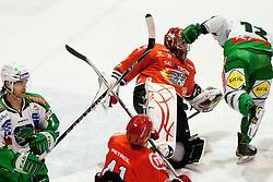 Brad Cole (HDD Tilia Olimpija, #2) vs Antti Pusa (HK Acroni Jesenice, #41) and in background Petr Sachl (HDD Tilia Olimpija, #12) crushes Michal Fikrt (HK Acroni Jesenice, #37) during ice-hockey match between HK Acroni Jesenice and HDD Tilia Olimpija in 34th Round of EBEL league, on December 26, 2011 at Dvorana Podmezaklja, Jesenice, Slovenia. (Photo By Matic Klansek Velej / Sportida)