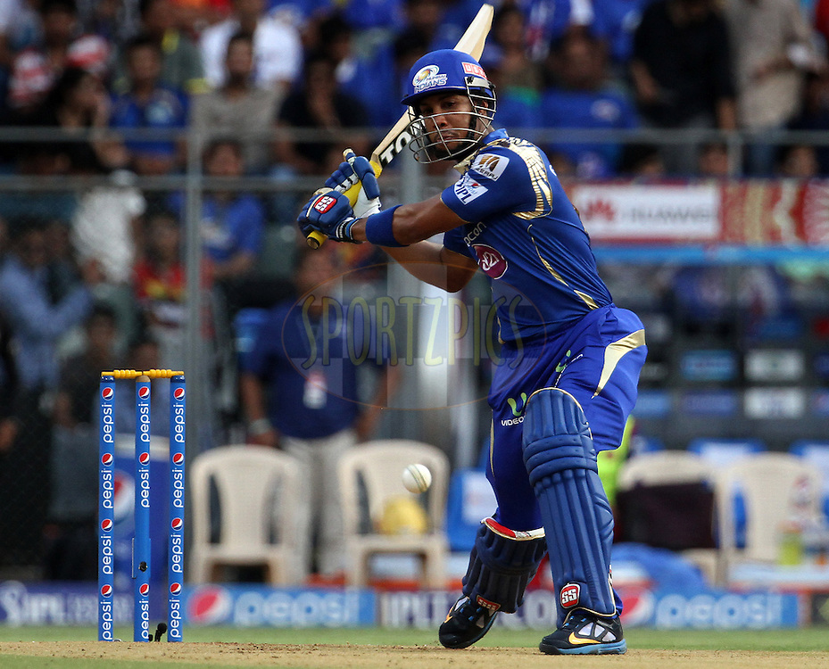 Mumbai Indians player Lendl Simmons plays a shot during match 46 of the Pepsi IPL 2015 (Indian Premier League) between The Mumbai Indians and The Royal Challengers Bangalore held at the Wankhede Stadium in Mumbai, India on the 10th May 2015.<br /> <br /> Photo by:  Vipin Pawar / SPORTZPICS / IPL