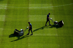Ground staff cut the pitch at The John Smith's Stadium ahead of Huddersfield Town v Derby County in the Sky Bet Championship - Mandatory by-line: Robbie Stephenson/JMP - 05/08/2019 - FOOTBALL - The John Smith's Stadium - Huddersfield, England - Huddersfield Town v Derby County - Sky Bet Championship