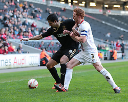 Crawley Town forward Rory Fallon (9) plays for time and is challenged by MK Dons defender Dean Lewington (3)   - Photo mandatory by-line: Nigel Pitts-Drake/JMP - Tel: Mobile: 07966 386802 12/04/2014 - SPORT - FOOTBALL -  Stadium MK - Milton Keynes - Milton Keynes Dons v Crawley Town - Sky Bet League One
