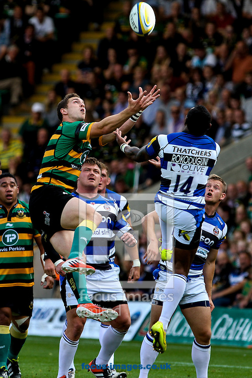George North of Northampton Saints (left)  competing with Semesa Rokoduguni of Bath Rugby (right) during the Aviva Premiership match at Franklin's Gardens, Northampton<br /> Picture by Andy Kearns/Focus Images Ltd 0781 864 4264<br /> 27/09/2014