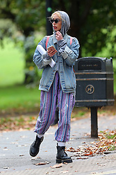 (EXCLUSIVE PICTURES) Actress Billie Piper's younger sister Elle Piper who is the spitting image of her older sister, spotted out wearing a denim jacket, hooded top, stripy trousers and black boots out in London, UK. 03/10/2019<br /> BYLINE MUST READ : JAMESY/GOTCHA IMAGES<br /> <br /> Copyright by © Gotcha Images Ltd. All rights reserved.<br /> Usage of this image is conditional upon the acceptance <br /> of Gotcha Images Ltd, terms and conditions available at<br /> www.gotchaimages.com