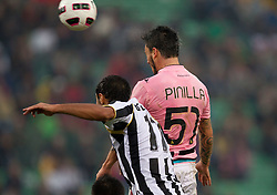 Benatia Al Mouttaqui Medhi of Udinese vs Pinilla Mauricio Ricardo Ferrera of Palermo vs  during football match between Udinese Calcio and Palermo in 8th Round of Italian Seria A league, on October 24, 2010 at Stadium Friuli, Udine, Italy.  Udinese defeated Palermo 2 - 1. (Photo By Vid Ponikvar / Sportida.com)