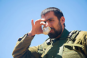 Israel, West Bank, Israeli reserve soldier drinking freshly brewed coffee at leisure during active duty
