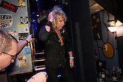Rick Parfitt of  the rock band Status Quo comes off stage after gig during European tour at L'Aeronef in Lille, France.