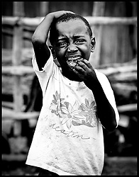 A child crys as he looks for his father in the slums in Kroobay area of Freetown, Sierra Leone June 2nd, 2008. Photo by Andrew Parsons/i-Images