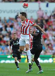 Christian Benteke of Liverpool challenges for the header with Philipp Wollscheid of Stoke City - Mandatory byline: Dougie Allward/JMP - 07966386802 - 09/08/2015 - FOOTBALL - Britannia Stadium -Stoke-On-Trent,England - Stoke City v Liverpool - Barclays Premier League