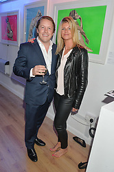 Left to right, EDWARD & AURORE OGDEN at a private view of an exhibition entitled 'All Shook Up' - by Natasha Archdale: A Retrospective held at 90 Piccadilly, London on 23rd April 2015.