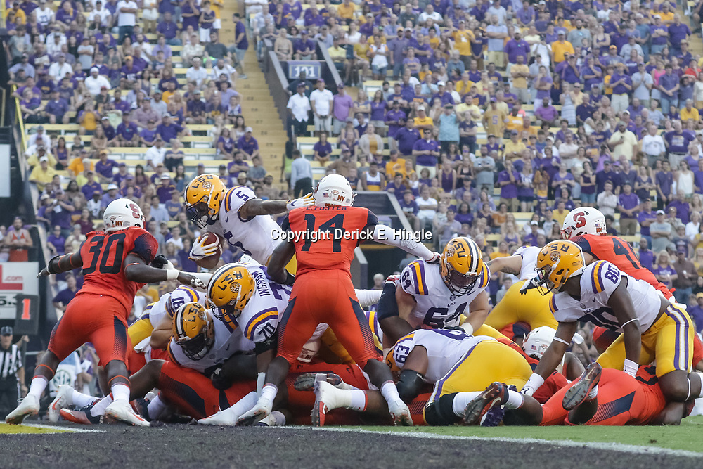 Sep 23, 2017; Baton Rouge, LA, USA; LSU Tigers running back Derrius Guice (5) scores against the Syracuse Orange during the first quarter of a game at Tiger Stadium. Mandatory Credit: Derick E. Hingle-USA TODAY Sports