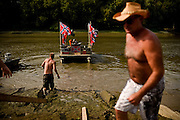 A pontoon boat that was a duck blind was decked with confederate flags and a horn for the 10th Annual Redneck Fishin' Tournament held Saturday, Sept. 5, 2015, in Bath, ILL. The only fishing tournament where poles are not allowed and you must catch the Asian Carp with a net or your hands as they fly through the air. This year 5,839 if the invasive species were removed from the Illinois River during the tournament. Photography by Rob Hart