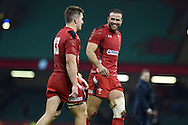 Wales players Jamie Roberts &reg; and Jonathan Davies celebrate their win at end of match. Dove Men series 2014, autumn international rugby match, Wales v South Africa at the Millennium stadium in Cardiff, South Wales on Saturday 29th November 2014<br /> pic by Andrew Orchard, Andrew Orchard sports photography.