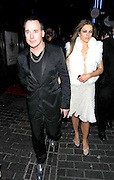 26.MAY.2011. LONDON<br /> <br /> LIZ HURLEY WITH DAVID FURNISH LEAVING THE BOX NIGHTCLUB IN SOHO, CENTRAL LONDON<br /> <br /> BYLINE: EDBIMAGEARCHIVE.COM<br /> <br /> *THIS IMAGE IS STRICTLY FOR UK NEWSPAPERS AND MAGAZINES ONLY*<br /> *FOR WORLD WIDE SALES AND WEB USE PLEASE CONTACT EDBIMAGEARCHIVE - 0208 954 5968*