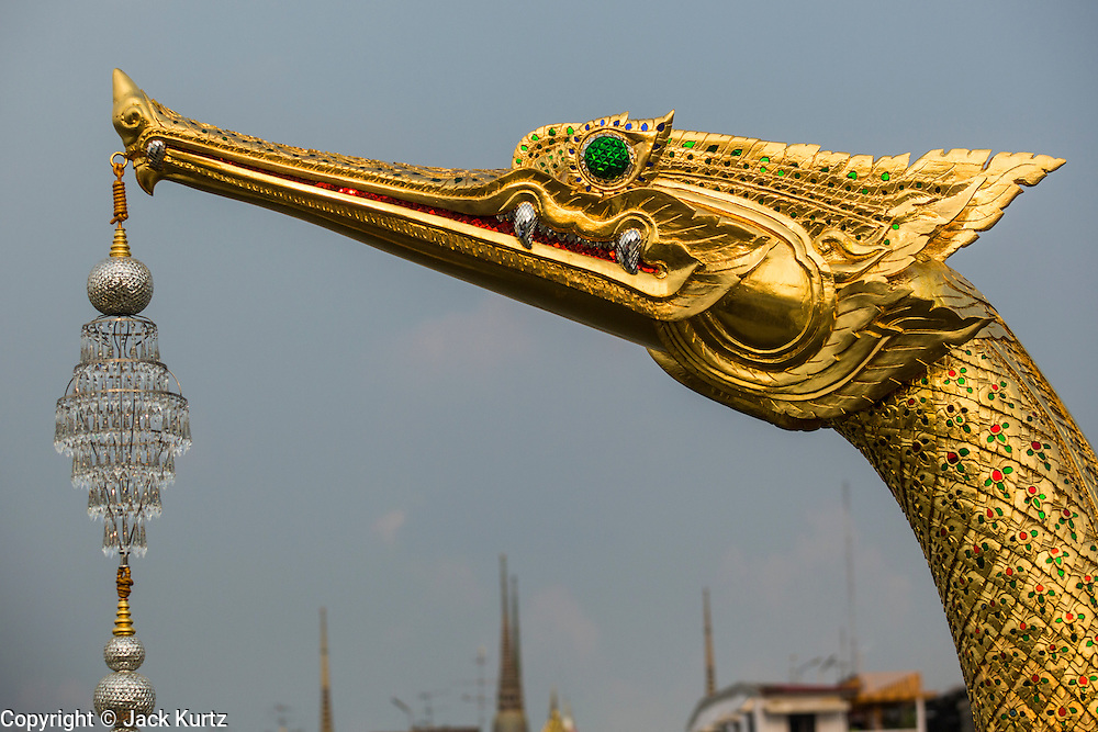 06 NOVEMBER 2012 - BANGKOK, THAILAND:  The ornamental prow of the Royal Barge Suphannahong on the Chao Phraya River in the dress rehearsal for the Royal Barge Procession. Thailand's Royal Barge Procession has both religious and royal significance. The tradition is nearly 700 years old. The Royal Barge Procession takes place rarely, typically coinciding with only the most important cultural and religious events. During the reign of King Bhumibol Adulyadej, spanning over 60 years, the Procession has only occurred 16 times. The Royal Barge Procession consists of 52 barges: 51 historical Barges, and the Royal Barge, the Narai Song Suban, which King Rama IX built in 1994. It is the only Barge built during King Bhumibol's reign. These barges are manned by 2,082 oarsmen. The Procession proceeds down the Chao Phraya River, from the Wasukri Royal Landing Place in Bangkok, passes the Grand Palace complex and ends at Wat Arun. Tuesday's dress rehearsal was the final practice for the 2012 Royal Barge Procession, which takes place November 9.     PHOTO BY JACK KURTZ