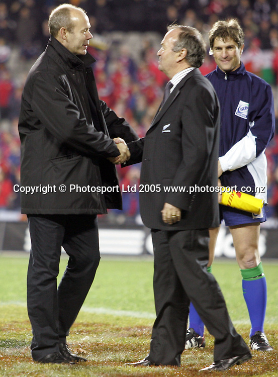 Lions coach Clive Woodward shakes hands with All Blacks coach Graham Henry after the 3rd test match between the All Blacks and the British and Irish Lions at Eden Park, Auckland, New Zealand on Saturday 9 July, 2005. The All Blacks won the match, 31 - 19 to win the series 3-0.  Photo: PHOTOSPORT<br />