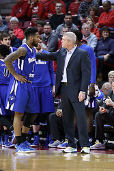20 January 2017:  Greg Lansing has a chat with point guard Demonte Ojinnaka during an NCAA Missouri Valley Conference mens basketball game Where the Purple Aces of Evansville lost to the Illinois State Redbirds 75-73 in Redbird Arena, Normal IL