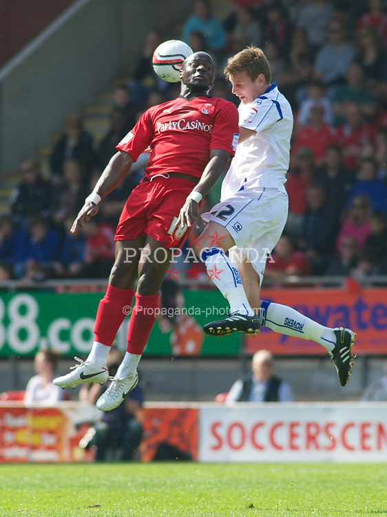 LONDON, ENGLAND - Saturday, April 30, 2011: Tranmere Rovers' Ash Taylor and Leyton Orient's Jonathan Tehoue in action during the Football League One match at Brisbane Road. (Photo by Gareth Davies/Propaganda)