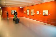 People viewing artworks inside Kode 4 art gallery Bergen, Norway