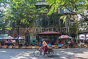 Rickshaw driver on a quiet Sunday in Bank Street, Yangon