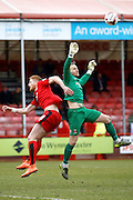 Crawley Town Forward Matt Harrold (18) jumps for the ball with Hartlepool United goalkeeper Trevor Carson (1) causing the keeper to spill it during the Sky Bet League 2 match between Crawley Town and Hartlepool United at the Checkatrade.com Stadium, Crawley, England on 19 March 2016. Photo by Andy Walter.