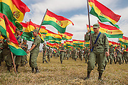 Carrying their national flag, Bolivian army troops starts to assemble before marching in the Independence Day parade in Santa Cruz, Bolivia, on Monday afternoon, Aug. 6, 2007.