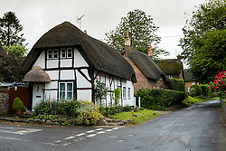 View of thatched cottages on main street in Wootton Rivers village in Wiltshire, England, United Kingdom